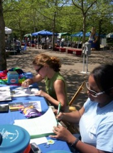 LEAP members work an information table at One Earth Day